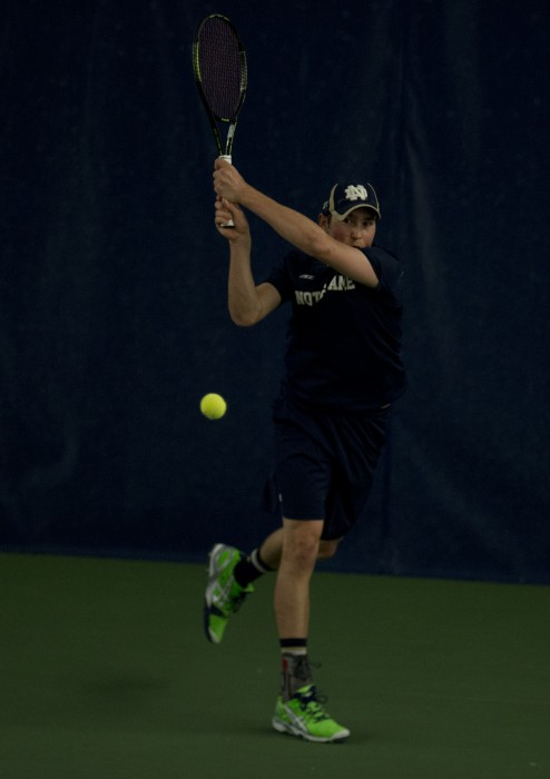 Senior Eric Schnurrenberger hits a backhand during Notre Dame's win against Kentucky on Feb. 2, 2014 at Eck Tennis Pavilion.