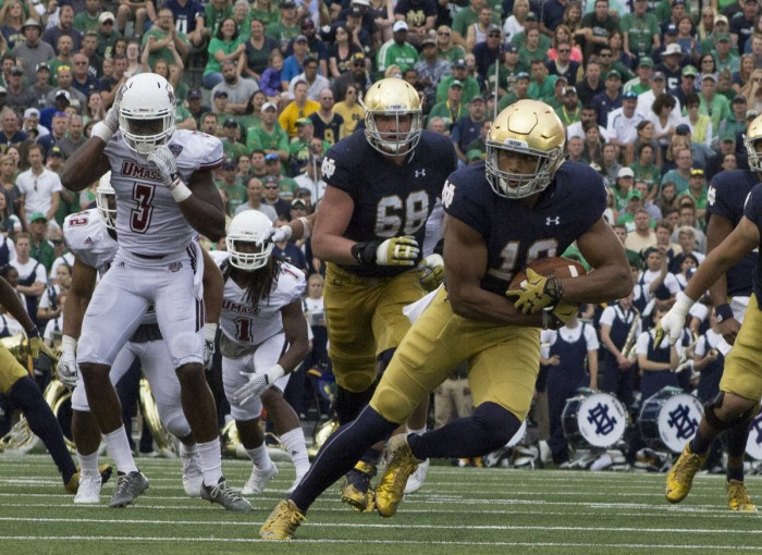 Freshman tight end Alizé Jones runs in space following a reception during Notre Dame's 62-27 win over Massachusetts. Jones was one of eight Irish players to catch a pass in Saturday's victory.