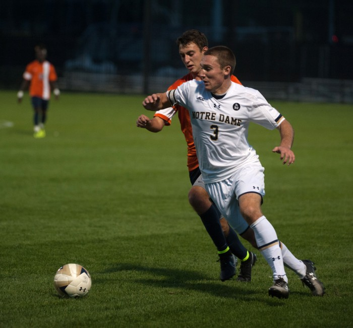 Senior midfielder Connor Klekota fends off a defender during a 3-1 win over Virginia at Alumni Stadium on Sept. 25.