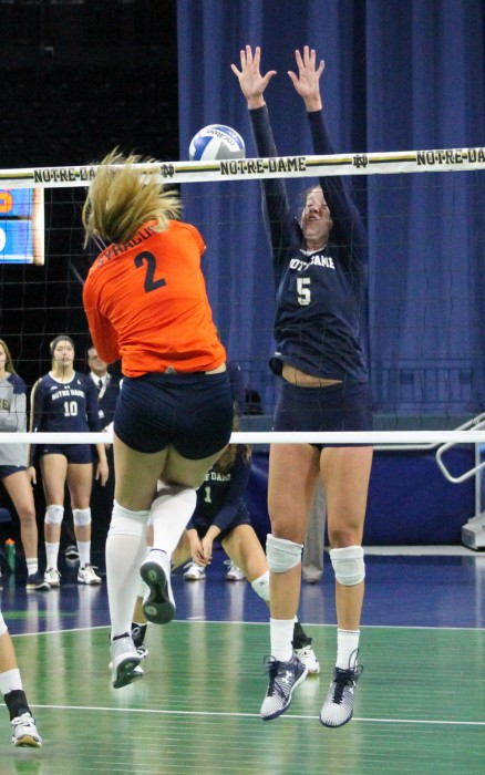 Sophomore outside hitter Sydney Kuhn jumps to block a hit during Notre Dame's 3-2 loss to Syracuse on Sunday at Purcell Pavilion.
