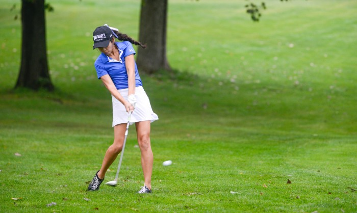Freshman Patty Meza hits the ball during the Michiana Crosstown Clash at Elbel Golf Course in South Bend on Aug. 29.