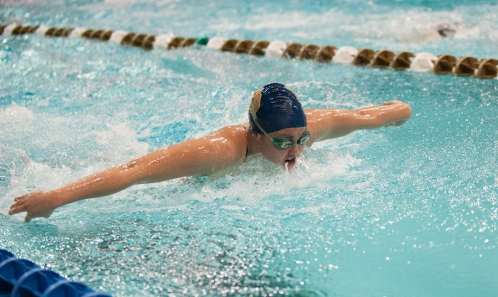 Irish sophomore Sherri McIntee competes in the 200-yard medley relay during the Shamrock  Invitational against Cleveland State on Feb. 7. McIntee finished with a time of 1:25.73.