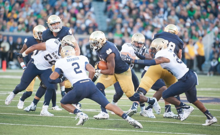 Irish senior running back C.J. Prosise finds a hole Saturday during Notre Dame's 41-24 victory over Navy. Prosise carried the ball 21 times for 129 yards and three touchdowns, bringing his season totals to 823 yards and nine touchdowns on the ground. Prosise also added four catches for 56 yards to his stat line.