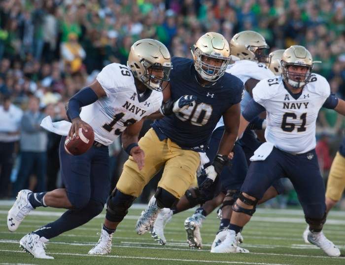 Irish senior defensive lineman Isaac Rochell chases after Navy senior quarterback Keenan Reynolds. Rochell recorded six tackles on the day, including one for a loss.