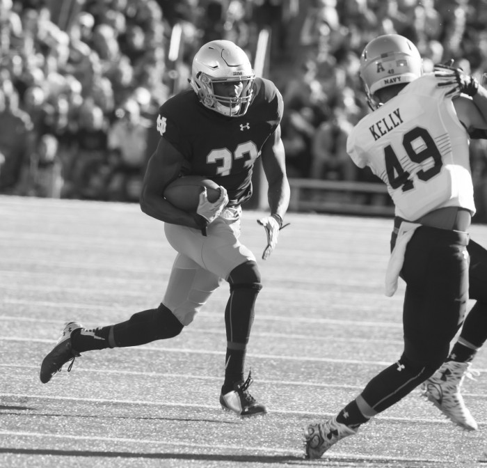 Irish freshman running back Josh Adams runs towards the cutback lane during Notre Dame's 41-24 win over Navy on Saturday at Notre Dame Stadium. Adams had eight carries for 38 yards in the game.