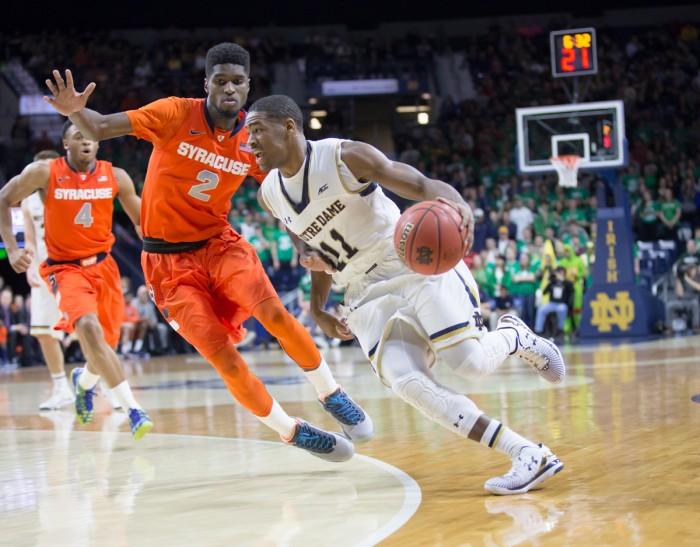 Irish junior guard Demetrius Jackson dribbles past a defender during Notre Dame's 65-60 loss against Syracuse on Feb. 24.
