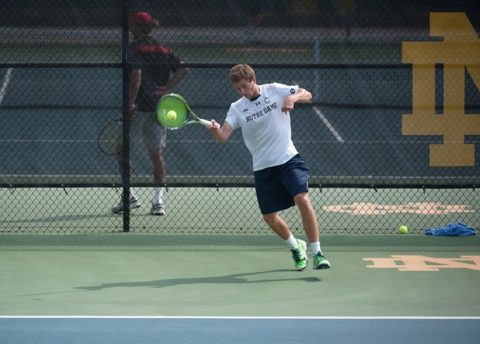 Irish senior and captain Quentin Monaghan hits a forehand during Notre Dame's 4-3 win over North Carolina State on April 18.