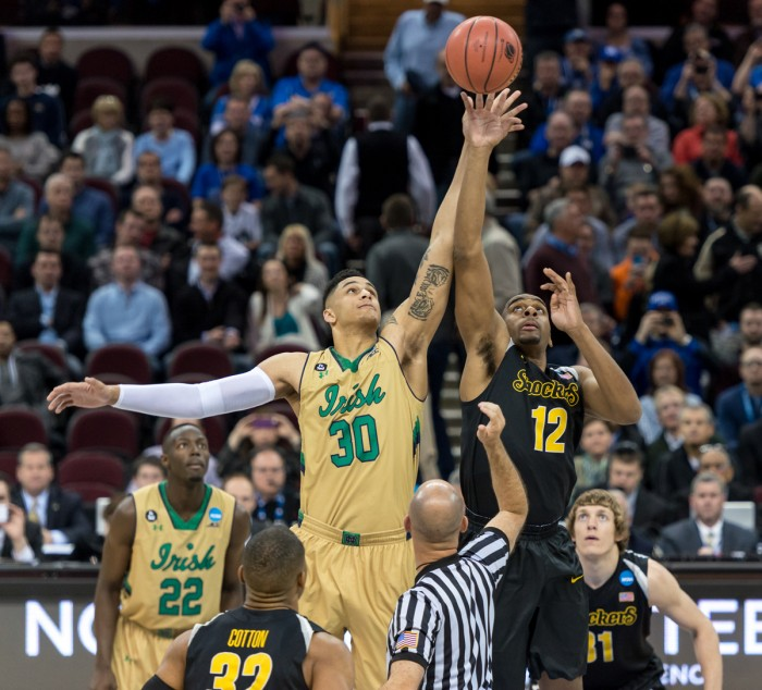 Irish senior forward Zach Auguste reaches for the tip-off at the start of a 81-70 victory against Wichita State on March 26 in Cleveland, OH.  Auguste had 15 points and six rebounds in the game.