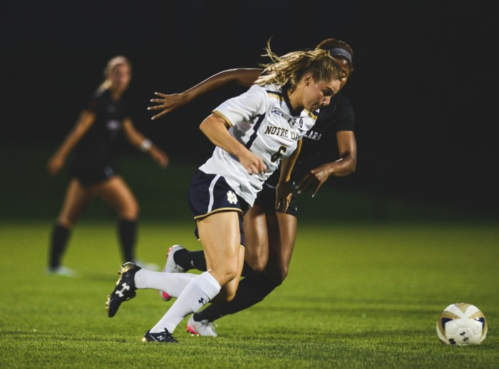 Senior forward Anna Maria Gilberston dribbles away from a defender during Notre Dame's 2-1 victory over Santa Clara on Aug. 28 at Alumni Stadium. Gilbertson had two goals in Friday's win against Virginia Tech.