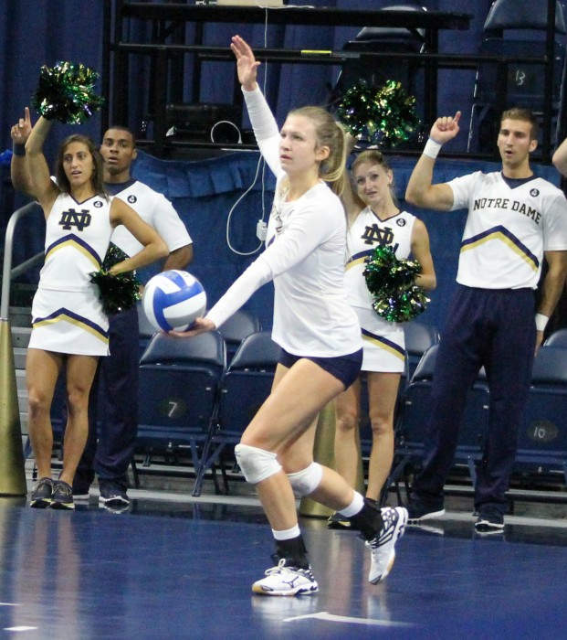 Freshman libero Ryann DeJarld sets up for a serve during Notre Dame's 3-2 loss against Syracuse on Oct. 4 at Purcell Pavilion.