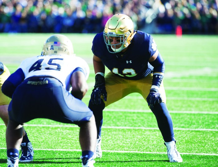 Irish sophomore tight end Tyler Luatua lines up across from Navy sophomore linebacker Micah Thomas during Notre Dame's 41-24 victory over the Midshipmen on Oct. 10 at Notre Dame Stadium.