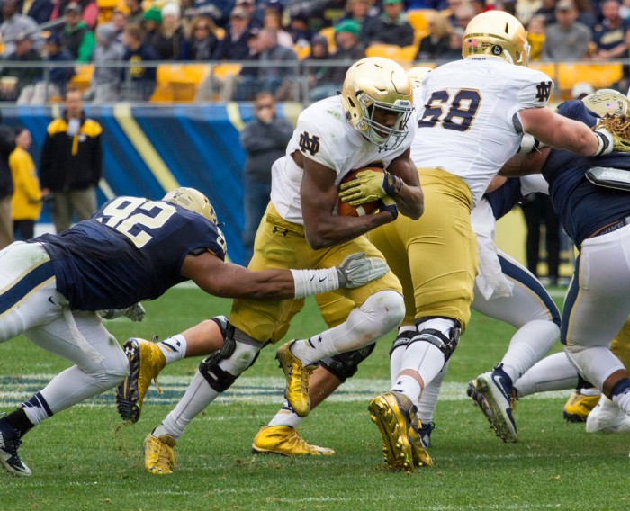 Freshman Josh Adams breaks through the line during Notre Dame's 42-30 win over Pittsburgh on Saturday at Heinz Field. Adams rushed for 147 yards on 20 touches to lead the Irish ground game.