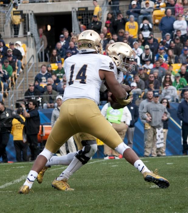 Sophomore quarterback DeShone Kizer, 14, and freshman running back Josh Adams run the read option Saturday in Pittsburgh.