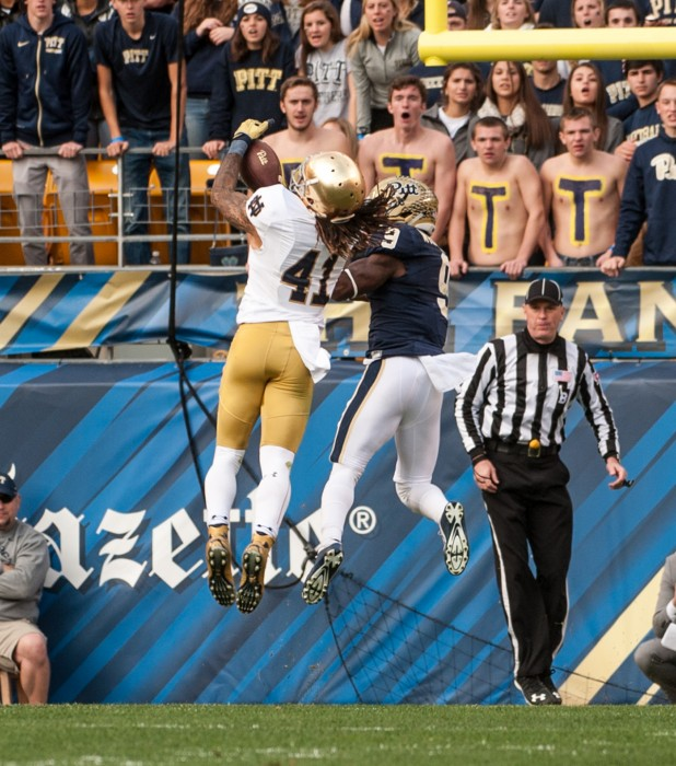 Irish graduate student cornerback Matthias Farley comes down with a second-quarter interception during Saturday's 42-30 win over Pitt at Heinz Field. Down 14-3, the Panthers were driving to cut into Notre Dame's lead, but Farley's interception of Panthers redshirt junior quarterback Nate Peterman at the 1-yard line kept the Irish two scores ahead.