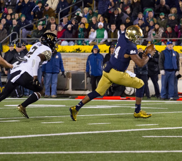 Irish sophomore quarterback DeShone Kizer carries the ball into the end zone to restore Notre Dame's three-score advantage in the fourth quaurter of Saturday's 28-7 win over Wake Forest.