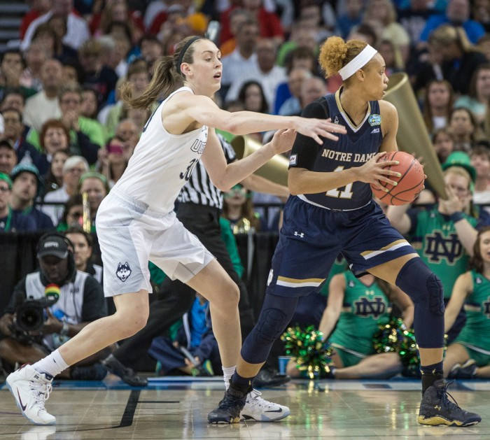 Sophomore forward Brianna Turner turns away from UConn defender Breanna Stewart during Notre Dame's 63-53 loss in the national title game April 7 at Amalie Arena in Tampa, Florida.