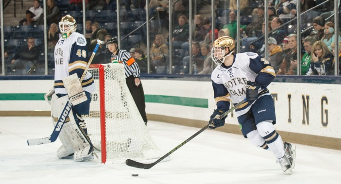 Sophomore defenseman Jordan Gross regroups behind the Notre Dame net during the 3-2 Irish victory over Northeastern on Nov. 12 at Compton Family Ice Arena. Gross had four shots in Friday's tie.