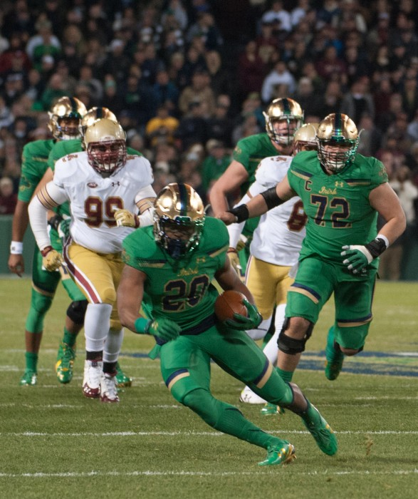 Senior running back C.J. Prosise makes a cut during Notre Dame's 19-16 victory over Boston College on Nov. 21 at Fenway Park.  Prosise carried the ball for 54 yards on nine attempts during the game.