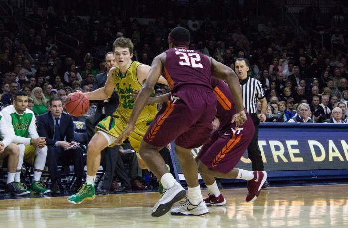 Irish junior guard Steve Vasturia looks to maneuver around two Virginia Tech defenders during Notre Dame's 83-81 victory on Wednesday at Purcell Pavilion. Vasturia filled in at point guard and scored 16 points Saturday after junior guard Demetrius Jackson left with an injury.