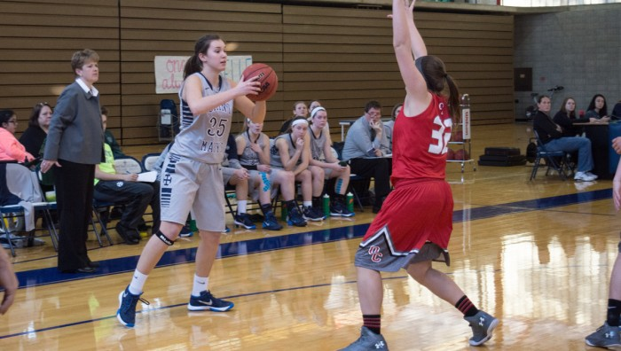 Belles sophomore forward Gabby Diamond surveys the defense during Saint Mary's 52-49 loss to Olivet on Saturday at Angela Athletic Facility. Diamond scored four points and pulled down two rebounds.