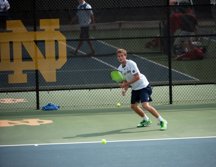 Irish senior Quentin Monaghan returns a shot during a 4-3 win over North Carolina State on April 18 at Courtney Tennis Center.