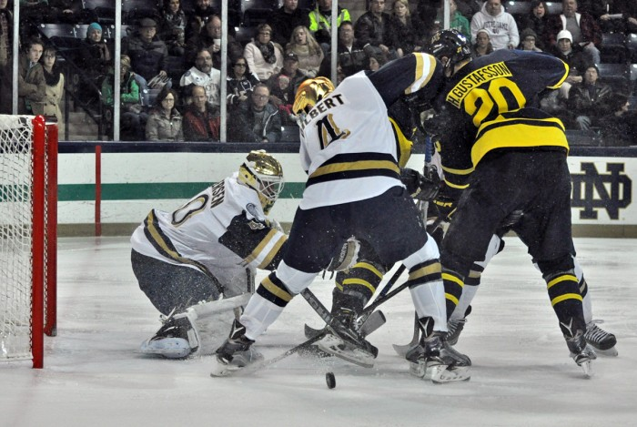 Irish sophomore goaltender Cal Petersen attempts to keep the puck out of his net during a 7-2 victory over Merrimack on Jan. 15. Petersen was recently named Hockey East goalie of the month for January.