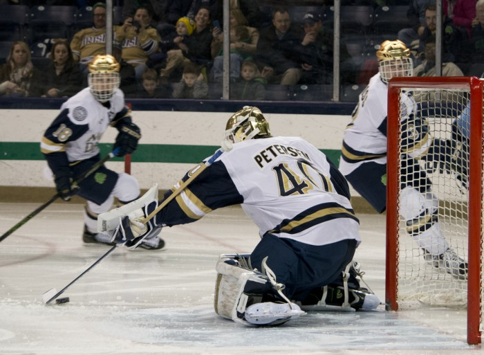 Irish sophomore goaltender Cal Petersen corrals a loose puck during Notre Dame's 5-1 win over Maine on Saturday.