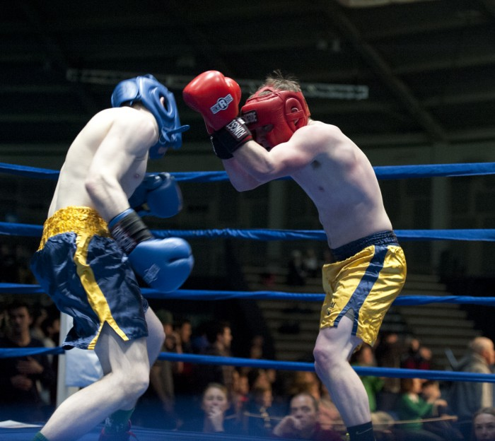 Adam Pasquinelly, right, clinches Ryan Dunn at Sunday night's preliminary bouts.