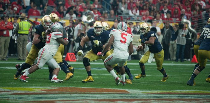 Irish junior offensive lineman Steve Elmer, left, looks to make a block during Notre Dame's 44-28 loss to Ohio State on Jan. 1.