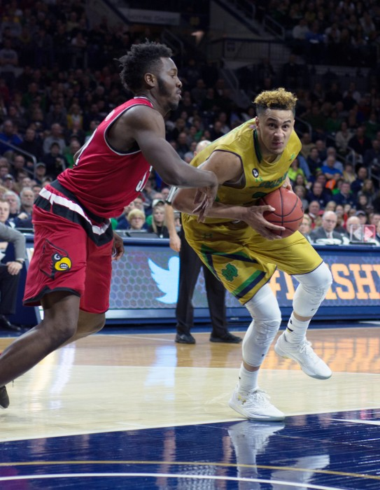 Irish senior forward Zach Auguste drives to the rim during Notre Dame's 71-66 win over Louisville on Feb. 13 at Purcell Pavilion.
