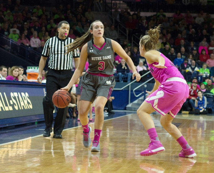 Irish freshman guard Marina Mabrey looks for a passing lane during Notre Dame's 90-69 victory over Miami on Feb. 13 at Purcell Pavilion. Mabrey scored 14 points and grabbed six rebounds in the game, and for the season the freshman is averaging 11.4 points per game.