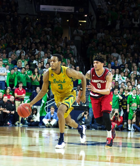 Irish junior forward V.J. Beacham brings the ball over midcourt during Notre Dame's 71-66 win over Louisville on Feb. 13.