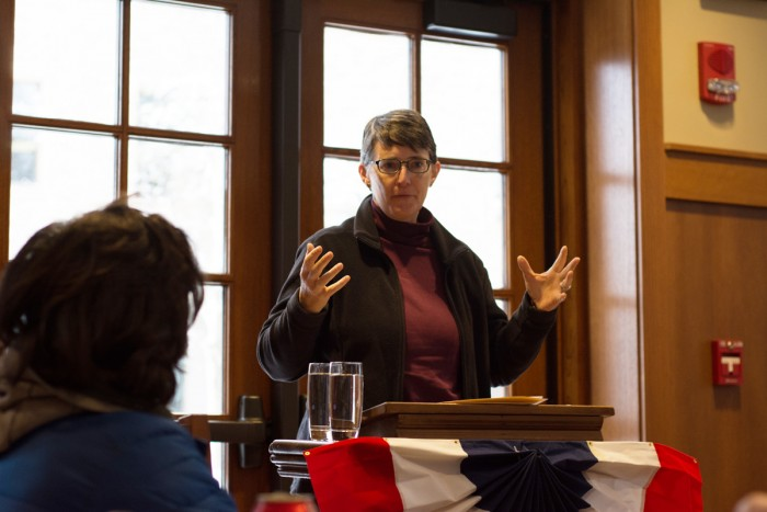 Margaret Pfeil, who holds a joint appointment in the theology department, spoke at an event about income inequality in terms of Catholic social thought and race.