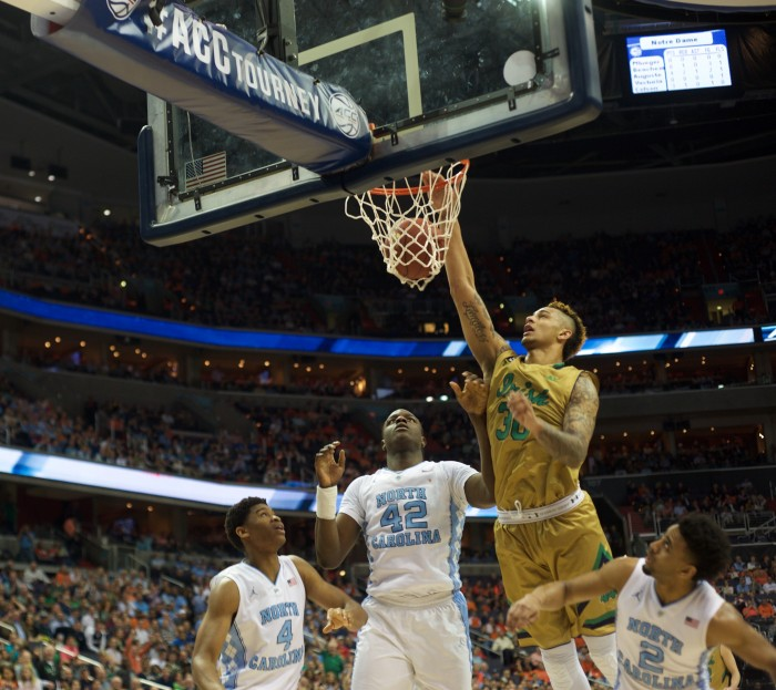 Senior forward Zach Auguste throws down a dunk during the ACC tournament last week in Washington.