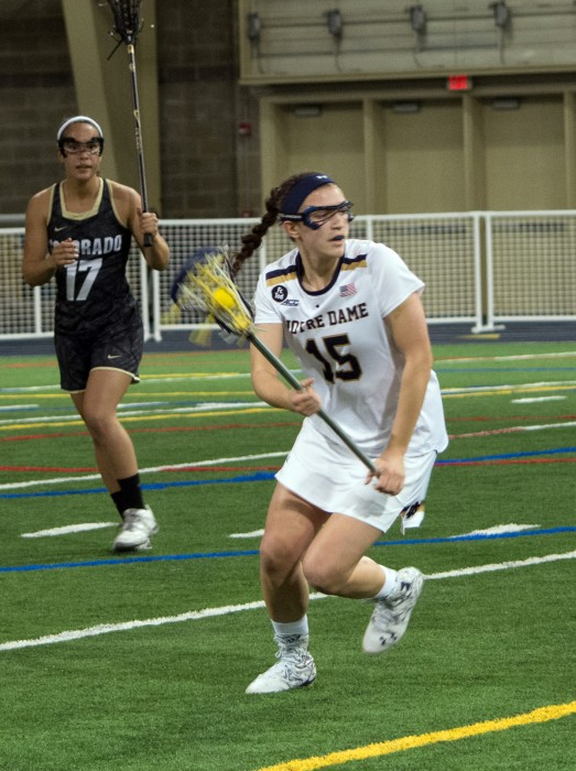Junior attack Cortney Fortunato advances the ball up the field during Notre Dame's 14-4 win over Colorado on Feb. 26. at Arlotta Stadium.