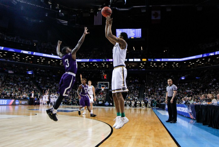 Junior forward V.J. Beachem starts off a four-point play with a made 3-pointer during Notre Dame's 76-75 win over Stephen F. Austin on Sunday at Barclays Center.