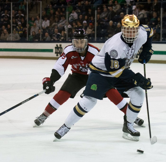Irish sophomore center Jake Evans skates up the ice during Notre Dame's 6-4 loss to Northeastern on March 12 at Compton Family Ice Arena. The Irish are set to join the Big Ten for hockey starting in the 2017-18 season.