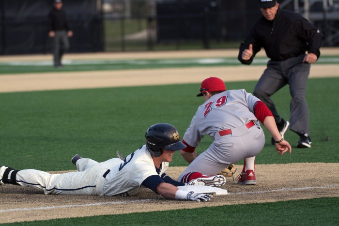 Junior second baseman Cavan Biggio slides into third during Notre Dame's 9-5 victory over UIC Tuesday. The Irish are back in action Friday for a weekend series at Virginia Tech.