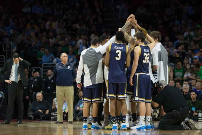 Notre Dame players huddle before their 88-74 loss to North Carolina on Sunday night in Philadelphia.
