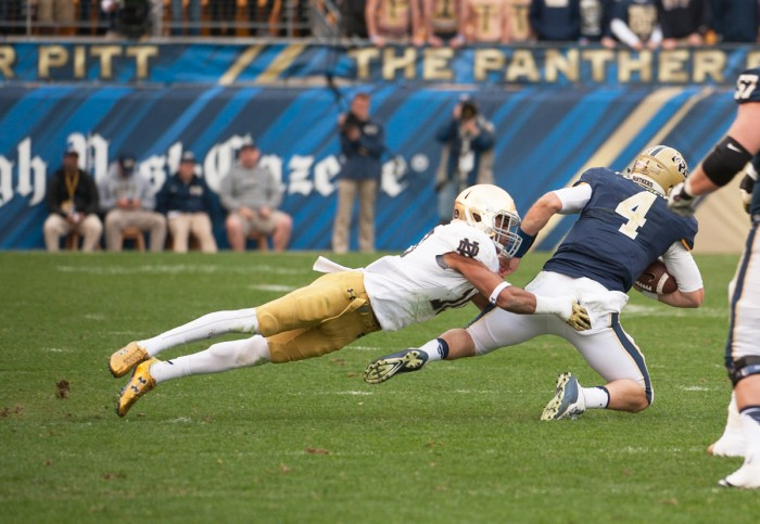 Irish senior safety Max Redfield takes down Pittsburgh quarterback Nate Peterman during Notre Dame's 42-30 win over the Panthers at Heinz Field in Pittsburgh. Redfield, who missed the Fiesta Bowl defeat to Ohio State after violating team rules, is one of five returning starters for the Irish on defense heading into the 2016 season.