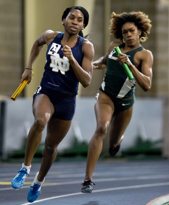 Irish senior Margaret Bamgbose rounds a corner during the 400-meter dash at the Notre Dame Invitational on Jan. 24, 2015. Bamgbose took first place in the same event at the Virginia Challenge on Friday.