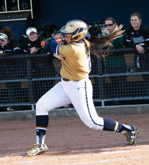 Irish senior first baseman Micaela Arizmendi swings at a pitch during Notre Dame's 10-2 win over Eastern Michigan on March 22.
