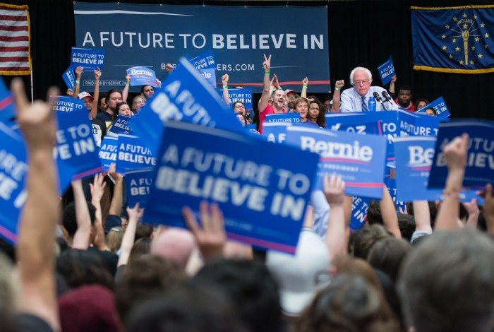 Supporters wave signs for Bernie Sanders at his rally Sunday. More than 4,000 people attended the event at the Century Center in South Bend.