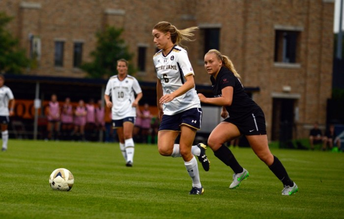 Irish senior forward Anna Maria Gilbertson dribbles away from a defender during Notre Dame's 2-1 victory over Santa Clara on August 28 at Alumni Stadium.
