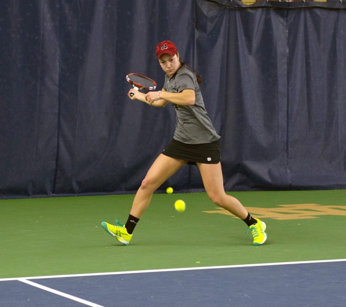 Irish senior Quinn Gleason prepares to hit a forehand during Notre Dame's 6-1 victory over Indiana at Eck Tennis Pavilion on Feb. 20. Gleason held a 20-12 record, the second best on the Irish squad.