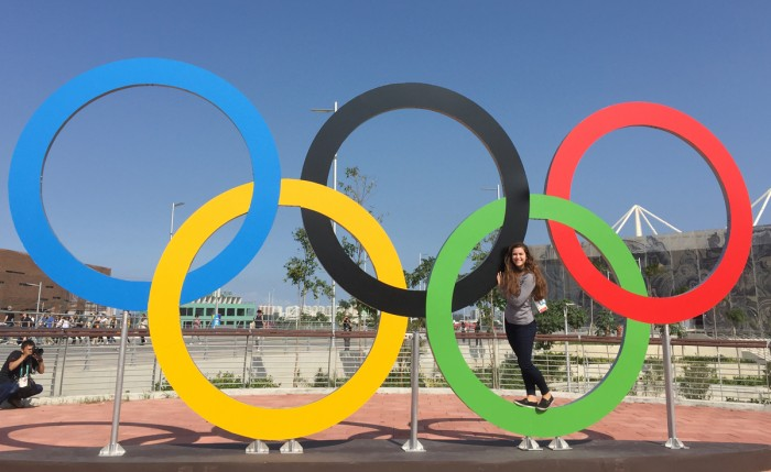 Senior Payton Erlemeier stands with the Olympic rings in Rio de Janeiro, where she was an NBC News intern for the Games over the summer after working for the network at Notre Dame football games.