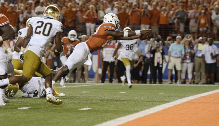 Longhorns senior quarterback Tyrone Swoopes dives into the end zone to secure Texas a 50-47 victory over Notre Dame at Darrell K. Royal-Texas Memorial Stadium on Sunday. Both teams scored touchdowns in the first overtime period before Texas held the Irish to a field goal and scored the winning touchdown in the game's second overtime.