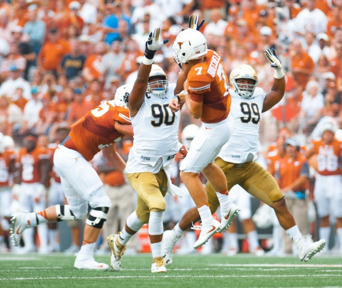 Irish senior Isaac Rochell, left, and sophomore Jerry Tillery, right, attempt to deflect a pass during Notre Dame's 50-47 loss to Texas.