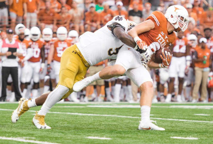 Notre Dame junior linebacker Nyles Morgan makes a tackle during Sunday's 50-47 loss to Texas.