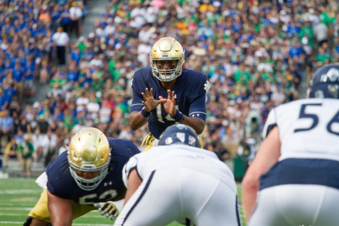 Irish junior quarterback DeShone Kizer prepares to take a snap during Notre Dame's 39-10 win over Nevada on Saturday.